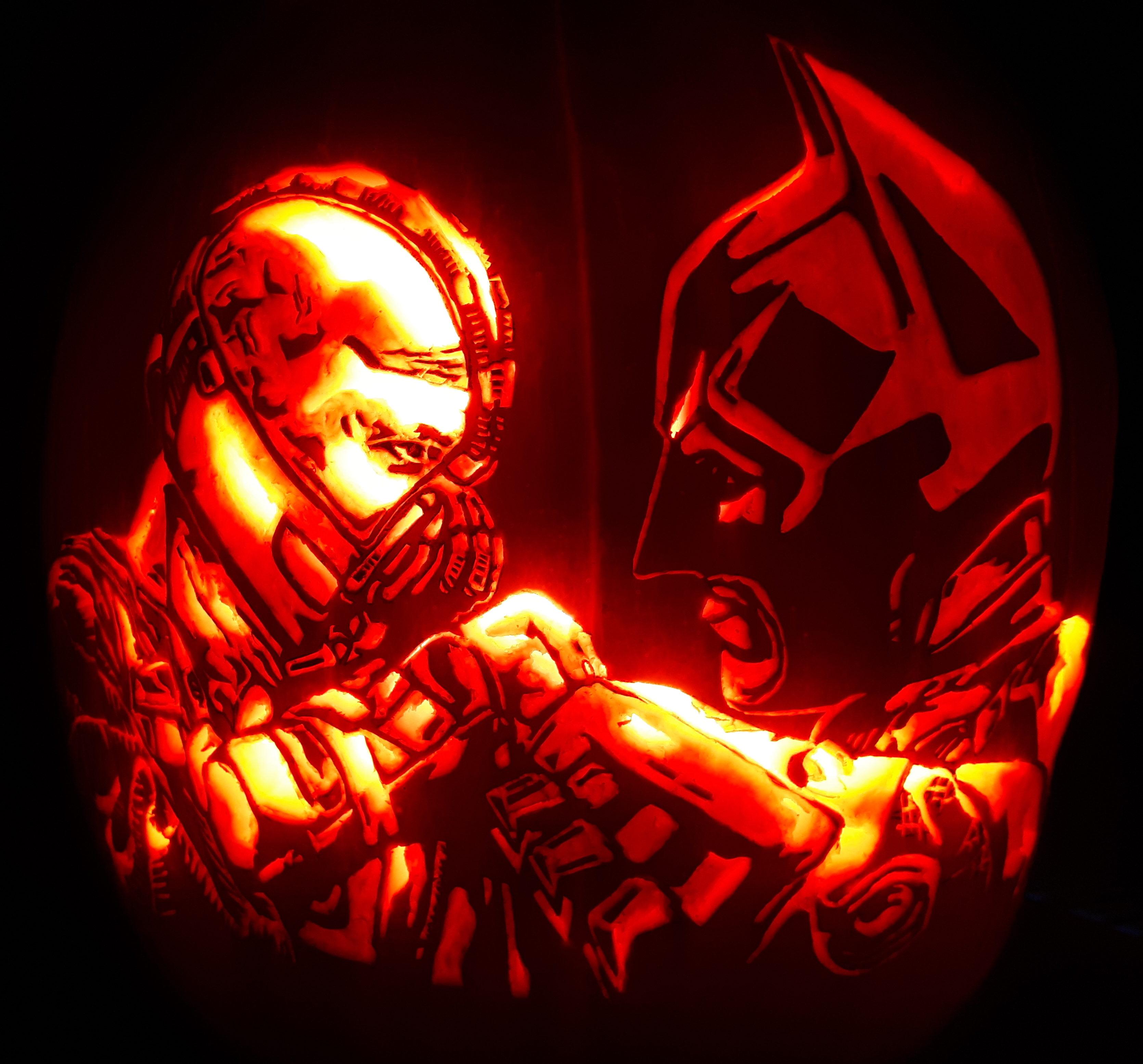 Bane and Batman Fighting Pumpkin